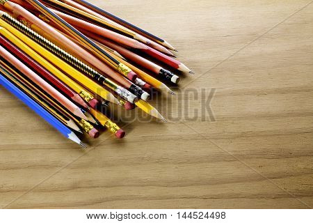 Collection of Pencils on a Wooden Background