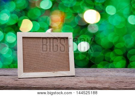 Blank wooden picture frame on wood table interior design and copy space