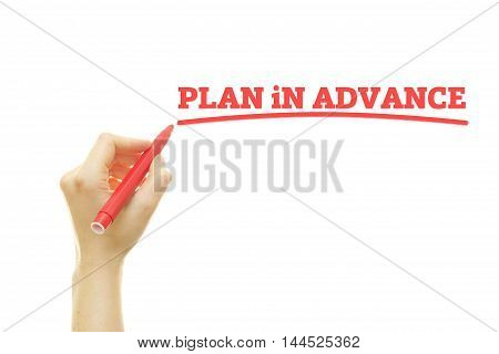 Woman hand writing Plan In Advance on a transparent wipe board.
