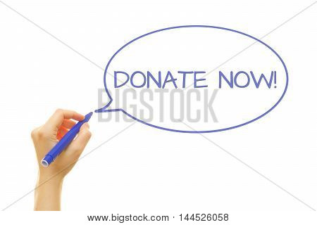 Woman hand writing Donate Now! on a transparent wipe board.
