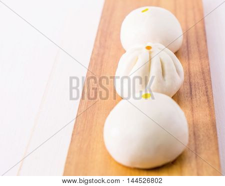 Fresh Chinese Bun dimsum on wooden tray