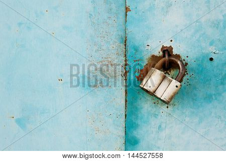 Outboard lock or padlock on vintage turquoise background. Protection system concept. Empty space for text.