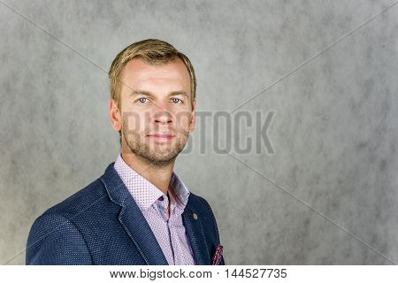 Businessman looking forward on gray background on a black background