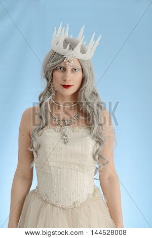 portrait of snow queen with blue background
