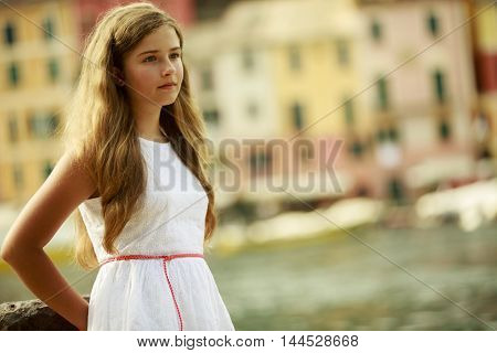 Portrait of young and beautiful girl in Portofino, Italy.