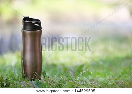 Bottle on a green grass