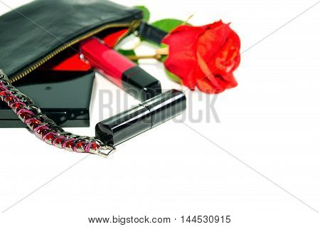 Lady's goods: make up bag, cosmetics and fashion jewerly on white background with soft shadows