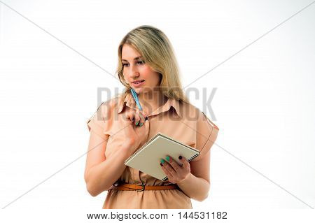 Portrait of beautiful young blonde woman thinking with a notepad, isolated on white background. Studio shoot