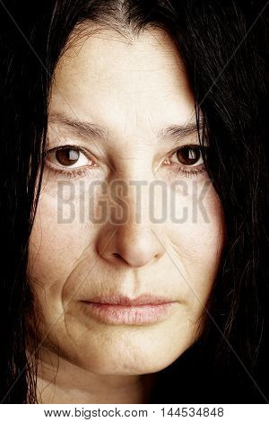 Close-up of a woman's face with a frightened or nervous