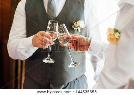 two Successful businessman toasting with Champagne. at the window