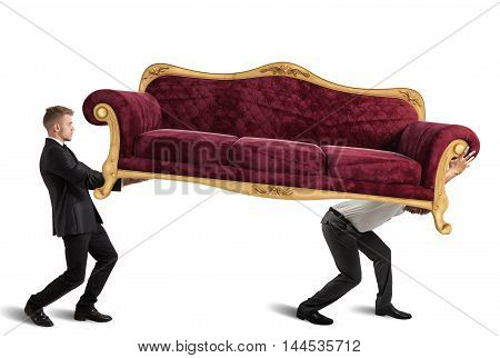 Men carrying a very heavy antique sofa
