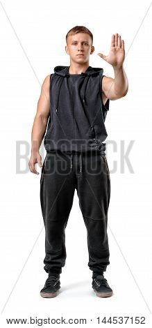 Full body portrait of handsome muscled young man showing stop hand sign isolated on white background. Healthy lifestyle. Fitness, sport, bodybuilding, workout. Wellness and beauty. Body language.