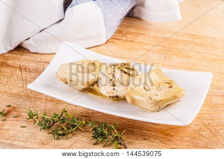 Artichokes Hearts With Herbs On Cutting Board