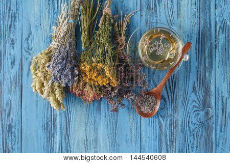 Cup Of Herbal Tea With A Lavender Bouquet