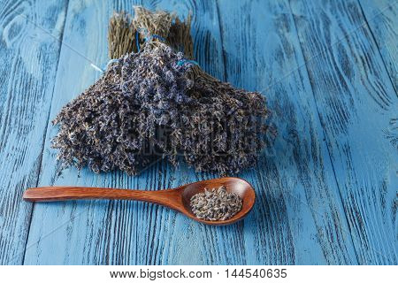 Dried lavender bunch. countryside scene on blue table