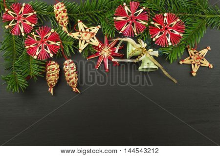 Christmas background. Christmas fir tree with decoration on a wooden board. Christmas background with balls and decorations over wooden table