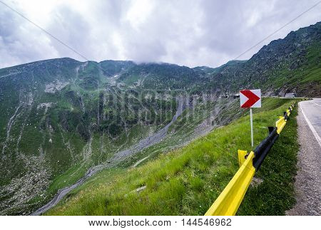 Turn sign on Transfagarasan Road in southern section of Carpathian Mountains in Romania