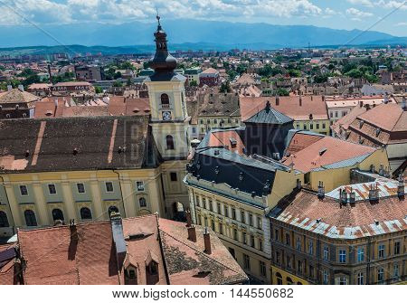 Holy Trinity Roman-Catholic Church seen from Saint Mary Lutheran Cathedral in Sibiu city in Romania