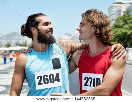 Two friends after the race outdoor in the city