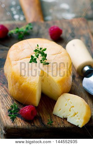 Smoced goat cheese .style vintage . selective focus