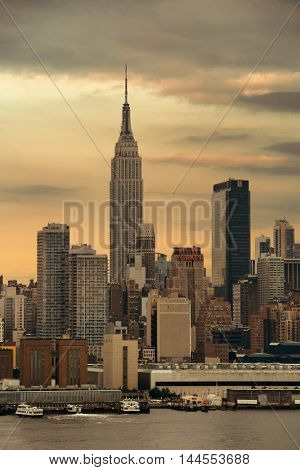 NEW YORK CITY - JUL 4: Empire State Building with skyscrapers on July 4, 2015 in Manhattan, New York City. With population of 8.4M, it is the most populous city in the United States.