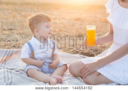 Small Cute Baby With His Mother On A Picnic.