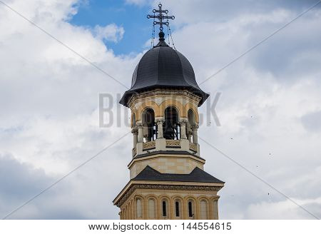 Bell tower of Coronation Cathedral deticated to Holy Trinity in Citadel of Alba Iulia city in Romania