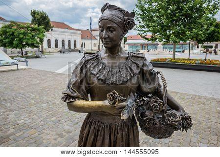 Bronze statue of woman with flowers in Citadel of Alba Iulia city in Romania