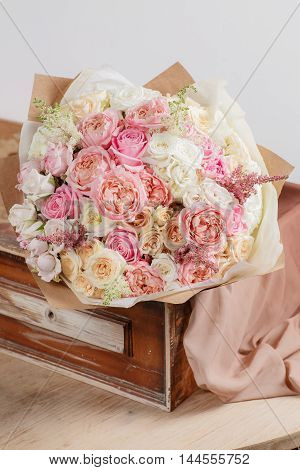 Composition Of Different Varieties  Roses. Florist Did Rich Bunch Flowers Light Background, Wooden S