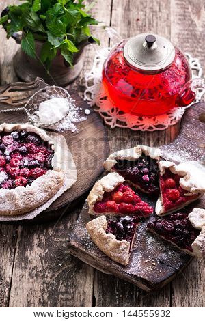 Blueberry,cherry,raspberry And Blackcurrant Galette On W Wooden Background.