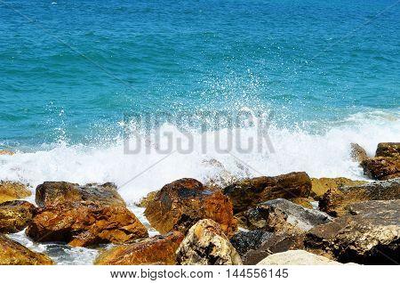 Sea Waves Break About Stones
