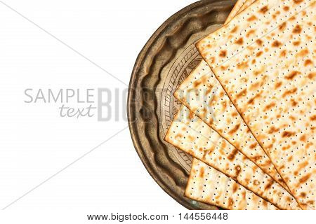 Matzo on vintage plate for passover holiday isolated on white background