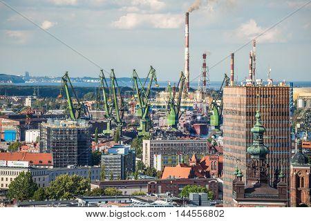 Gdansk Poland- September 192015:Big green cranes in shipyard of Gdansk Poland.