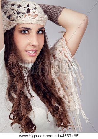 fashion young woman  with scarf on her head, on gray background