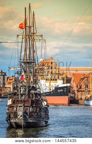 GdanskPoland-September 192015:Tourist ship and colourful historic houses reflection Motlawa river in port of Gdansk Baltic Sea Poland.