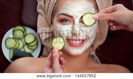 smiling girl with cosmetic mask, natural beauty comes from natural ingredients