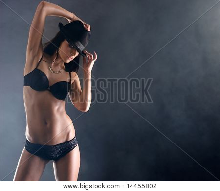 Sexy woman in erotic lingerie over smoky background