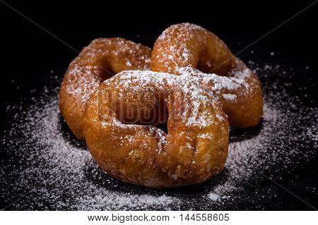 Sprinkling Sugar Powder On Donut