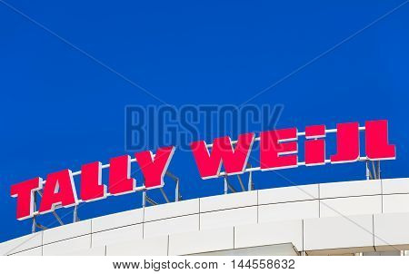 Basel, Switzerland - 27 August, 2016: Tally Weijl sign on the top of an office building. Tally Weijl is a fashion label based in Basel Switzerland, it is represented worldwide in 37 countries with over 780 stores.