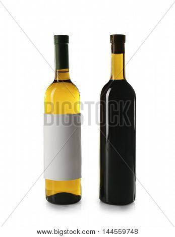 Bottles of white and red wine isolated on white