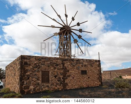 OLHistoric wooden wind mill in Valles de Ortega with twelve wings on the Spanish island Fuerteventura one of the Canary islands in the Atlantic Ocean belonging to Spain
