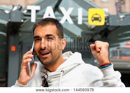 Man feeling lacky in order a taxi from his cell phone