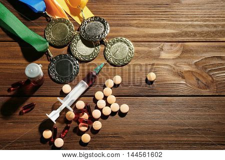 Syringe with pills and medals. Doping in sport concept