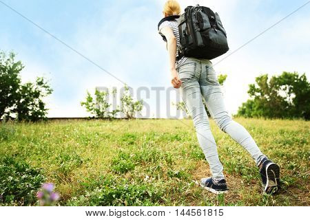Woman walking on a meadow
