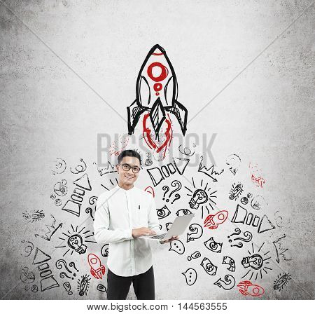 Asian Man With Laptop And Rocket Sketch