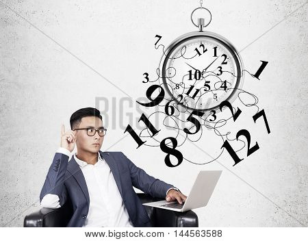 Asian Businessman And Stopwatch