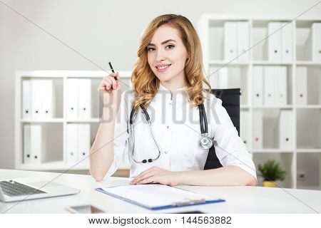 Smiling Woman Doctor In Office