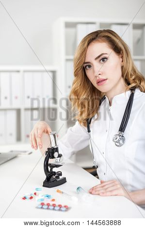 Woman Doctor With Microscope