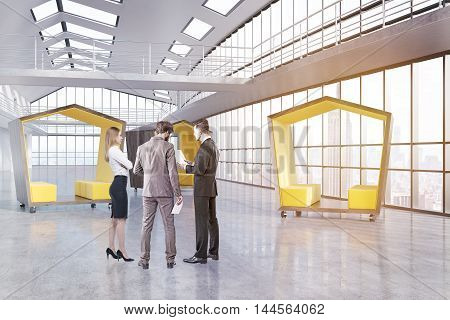 Group of colleagues standing in company's lobby near pentagonal waiting rooms. Concept of brainstorming. 3d rendering