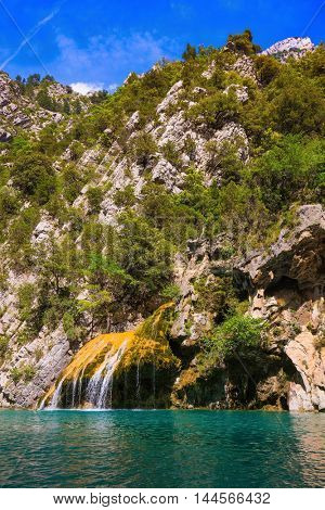 The picturesque azure waterfall on the side wall of canyon Verdon. National park Merkantur, Provence, France